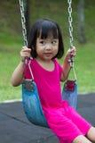 Азиатское качание ребенк на парке Стоковые Фото