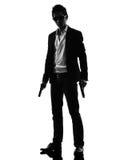 Азиатское положение убийцы вооруженного человека   силуэт стоковые фотографии rf