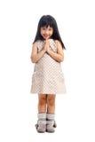 Азиатское приветствие ребенка с sawasdee стоковое изображение rf