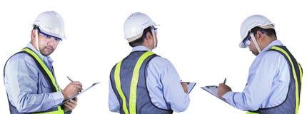 Азиатское сочинительство инженера на доске сзажимом для бумаги Стоковая Фотография RF