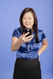 азиатское pda дела используя женщину Стоковая Фотография