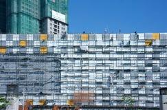 Азиатское scraffold рабочий-строителя, строительная площадка Стоковые Фото