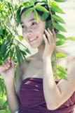 Азия смотрит на женщину при свежая кожа здоровья представляя на природе Стоковое Изображение RF