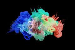 Акриловые цвета в воде E стоковое фото