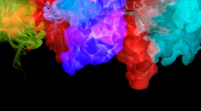 Акриловые цвета в воде. Абстрактная предпосылка. стоковое изображение rf