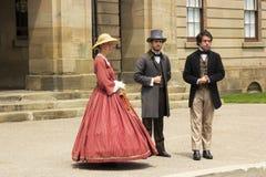 Актеры одетые как отцы и дамы конфедерации в Charlot стоковое фото