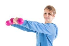активные гантели предпосылки изолировали жизнь над ся sporty детенышами белой женщины здоровья Стоковое Фото