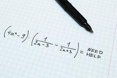 Алгебра, помощь потребности Математически тетрадь стоковая фотография