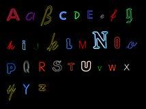 алфавит помечает буквами неон Стоковая Фотография