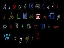 алфавит помечает буквами неон Стоковые Фото