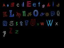 алфавит помечает буквами неон Стоковое Изображение RF