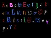 алфавит помечает буквами неон Стоковые Изображения RF
