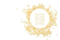 Алфавит сделанный изолированных писем макарон на белой предпосылке w стоковая фотография