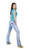 дама стоя против изолированной белой предпосылки Стоковая Фотография RF