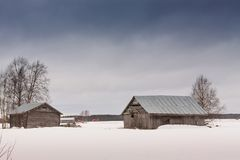 Амбары на полях снега Стоковое Изображение RF