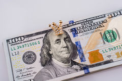 Американец 100 банкнот доллара и крона Стоковые Фото
