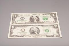 Американец денег одна и 2 долларовой банкноты Стоковая Фотография
