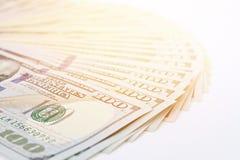 Американские доллары денег наличных денег на белой предпосылке Стоковые Фотографии RF