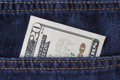 американские доллары карманн джинсыов Стоковые Фотографии RF