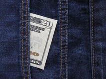 американские доллары карманн джинсыов Стоковая Фотография RF