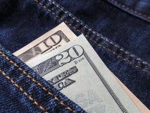 американские доллары карманн джинсыов Стоковая Фотография