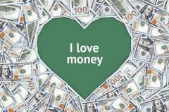Американские доллары положены вне в форме сердца Стоковое фото RF