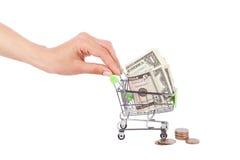 Американские доллары в изолированном pushcart покупок, Стоковые Фотографии RF