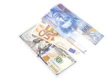 Американские доллары, европейское евро и банкноты швейцарского франка Стоковое фото RF