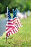 Американские флаги ветерана в кладбище Стоковые Изображения