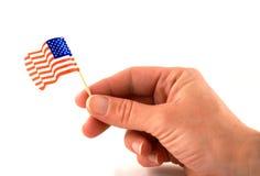 американский флаг задерживая Стоковые Фото