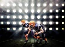 Американский футболист в действии стоковое фото