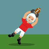 Американский футболист улавливая шарик Стоковая Фотография RF