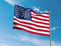 Американский флаг развевая в голубом небе Стоковая Фотография
