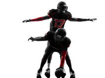 2 американских футболиста на силуэте схватки Стоковая Фотография