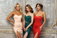 3 дамы в платьях вечера Стоковое фото RF
