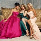 3 дамы в платьях вечера Стоковые Фото