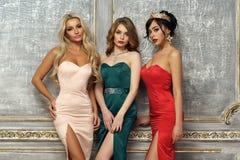 3 дамы в платьях вечера Стоковое Фото
