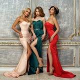 3 дамы в платьях вечера Стоковая Фотография