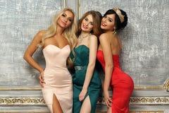 3 дамы в платьях вечера Стоковое Изображение