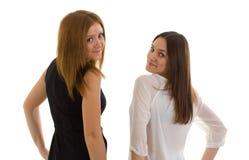 2 дамы на белой предпосылке Стоковые Фотографии RF