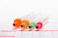 Анализ крови, пробы крови на форме лаборатории Стоковые Изображения RF