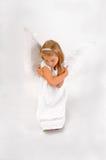 Ангел на коленях Стоковая Фотография