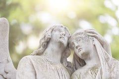 2 ангела в подсвеченном Стоковые Фото