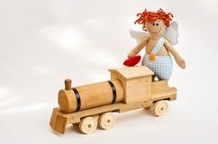 Ангел куклы с его руками на белой предпосылке Стоковые Изображения RF