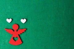 Ангел на зеленой предпосылке, деревянное украшение рождества eco, игрушка Стоковое Фото