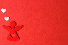 Ангел на красной предпосылке, деревянное украшение рождества eco, игрушка Стоковое Фото