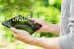Английская концепция с человеком держа его планшет стоковое фото rf