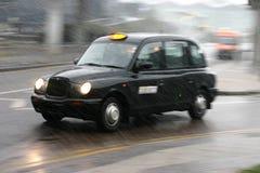 английский таксомотор Стоковая Фотография