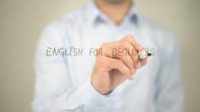 Английский язык для Beginners, сочинительство человека на прозрачном экране стоковая фотография rf