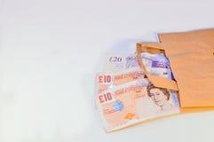 Английские фунты в сумке Стоковое Фото